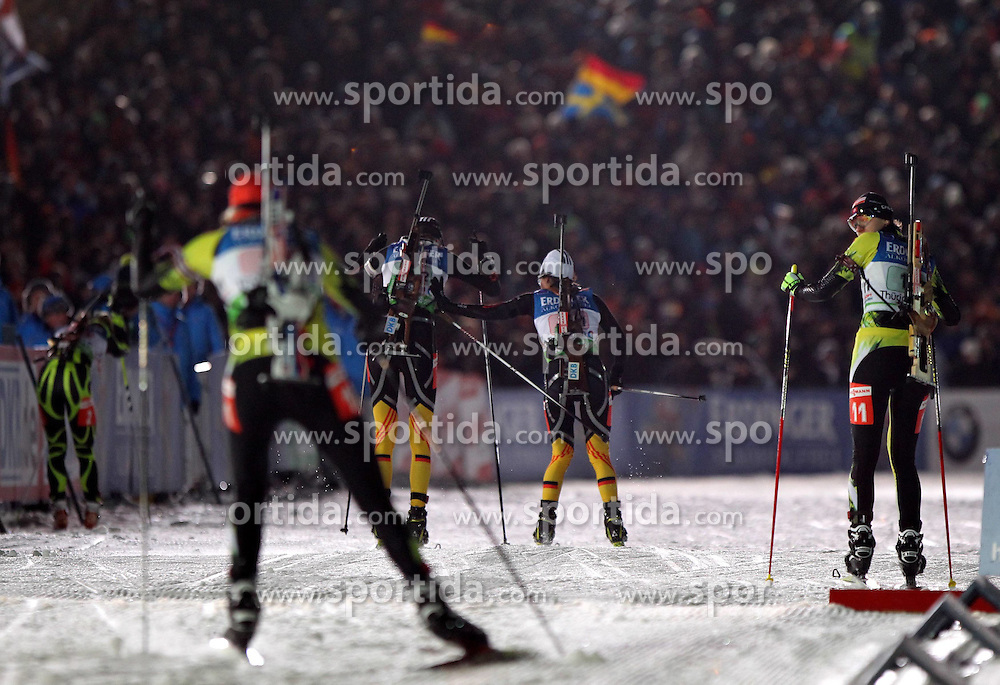 04.01.2012, DKB-Ski-ARENA, Oberhof, GER, E.ON IBU Weltcup Biathlon 2012, Staffel Frauen, im Bild Staffelübergabe von Andrea Henkel (GER) auf Tina Bachmann (GER) .// during relay Ladies of E.ON IBU World Cup Biathlon, Thüringen, Germany on 2012/01/04. EXPA Pictures © 2012, PhotoCredit: EXPA/ nph/ Hessland..***** ATTENTION - OUT OF GER, CRO *****