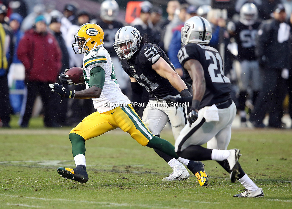Green Bay Packers running back James Starks (44) runs away from Oakland Raiders inside linebacker Ben Heeney (51) and Oakland Raiders cornerback Dexter McDonald (21) as he runs for a 25 yard first down at the Raiders 8 yard line for a first and goal in the fourth quarter during the 2015 week 15 regular season NFL football game against the Oakland Raiders on Sunday, Dec. 20, 2015 in Oakland, Calif. The Packers won the game 30-20. (©Paul Anthony Spinelli)