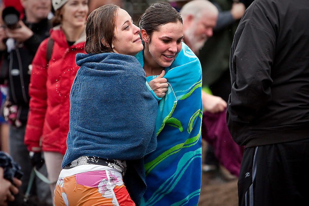 JEROME A. POLLOS/Press..Erin Cory, left, and Leah Archibald huddle under their towels to keep warm after getting out of the water.