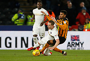 Adam Forshaw of Leeds United is fouled by Fraizer Campbell of Hull City during the EFL Sky Bet Championship match between Hull City and Leeds United at the KCOM Stadium, Kingston upon Hull, England on 30 January 2018. Photo by Paul Thompson.
