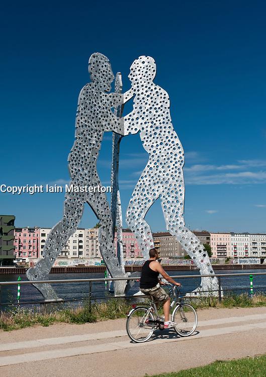 Huge Metallic sculpture called Molecule Man by Jonathan Borofsky in Spree River Berlin