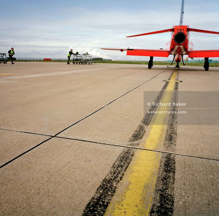 Engineering ground staff of the Red Arrows, Britain's RAF aerobatic team during winter training turnaround.
