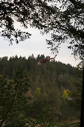 CalFire Fighting helicopter taking off after refilling tanks at local golf course as the fire races into the Hoberg's Resort area (Kim Ringeisen / Polaris)