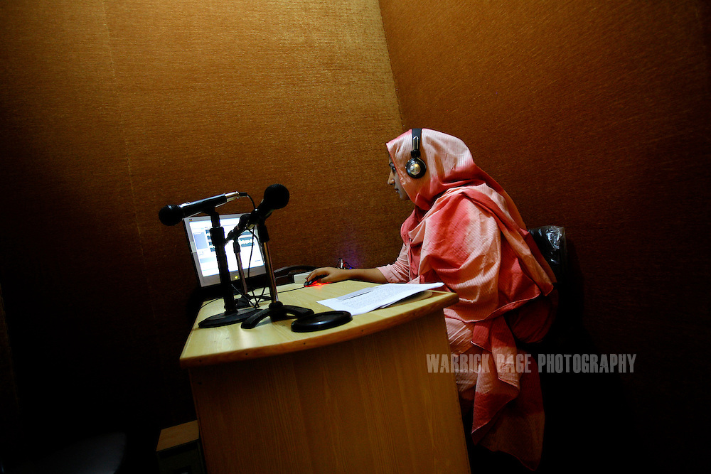PESHAWAR, PAKISTAN - MAY 8: Producer, Freshta Shikhany, edits a radio program in a sound booth at Pact Radio studios, May 8, 2008, in Peshawar, Pakistan. Pact Radio is a non-governmental organisation based in Peshawar, that trains madrassa students in radio reporting. The group also broadcasts in Pakistan's tribal belt and in war-torn Afghanistan, to provide an alternative viewpoint through without the use of commentary. Muslim extremists have used modern media to great effect in spreading their message of hate and violence on a global scale. Hundreds of illegal radio stations set up by hardline preachers in Pakistan broadcasting their violent and intolerant interpretation of Islam. (Photo by Warrick Page)