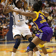 Sisters Chiney Ogwumike, (left), Connecticut Sun and Nneka Ogwumike, Los Angeles Sparks, (wearing face mask), playing against each other for the fist time in the WNBA during the Connecticut Sun Vs Los Angeles Sparks WNBA regular season game at Mohegan Sun Arena, Uncasville, Connecticut, USA. 3rd July 2014. Photo Tim Clayton
