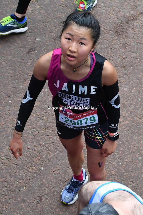 London, England, UK. 28 April 2019. Yan Ting from China finish the Virgin Money London Marathon at Pall Mall.