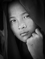 WANGDUE PHODRANG, BHUTAN - CIRCA OCTOBER 2014: Portrait of young monk looking at camera in Bhutan