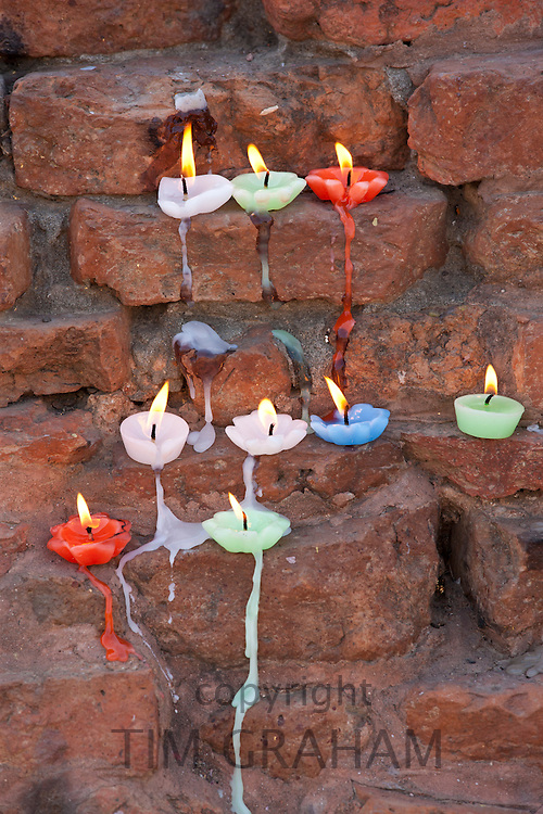 Lighted candles offering Buddhist prayers at Dharmarajika Stupa at Sarnath near Varanasi, Northern India