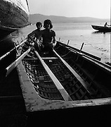 Dingle Regatta.22/08/1976.08/22/1976.22nd August 1976.Picture of curragh rowers relaxing in their boat after the Seine boat race.