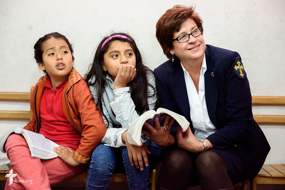 Deaconess Jacqueline Duke, LCMS career missionary to Peru, sits with children from Castillo Fuerte as they listen to a Bible activity on Saturday, Nov. 4, 2017, in the La Victoria district of Lima, Peru. LCMS Communications/Erik M. Lunsford