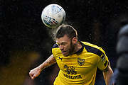 Jamie Mackie of Oxford United heads the ball during the EFL Sky Bet League 1 match between Southend United and Oxford United at Roots Hall, Southend, England on 6 October 2018.