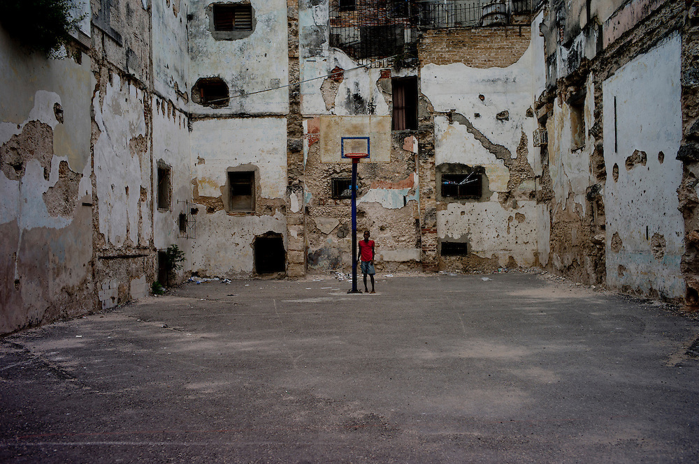 A boy plays in an empty site in Havana Vieja, one of the most over populated areas in the world. Cuba. October 30, 2012. Photo/Tomas Munita