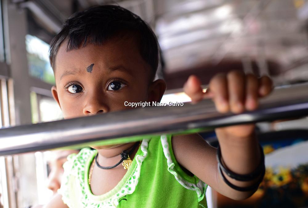 Cute young girl on the bus, Sri Lanka