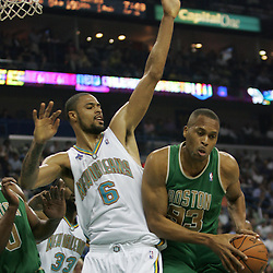 P.J. Brown #93 of the Boston Celtics posts up against New Orleans Hornets center Tyson Chandler #6  in the second quarter of their NBA game on March 22, 2008 at the New Orleans Arena in New Orleans, Louisiana. The New Orleans Hornets defeated the Boston Celtics 113-106.