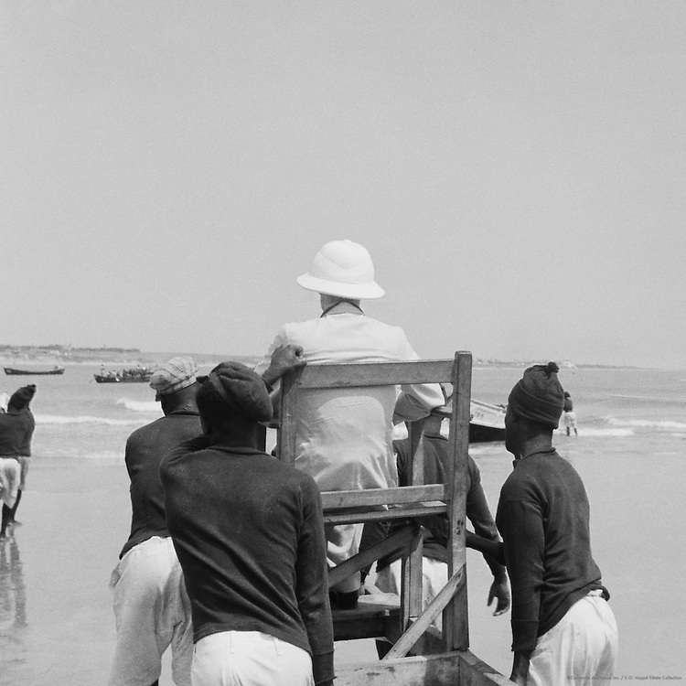"Passenger Carried in ""Mammy"" Chair Through Surf,  Accra, Ghana, Africa, 1937"