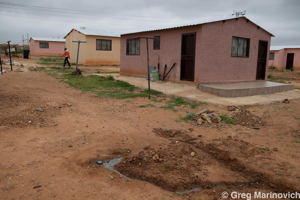 RDP or state housing in Soweto's Protea South show the effects of poor construction and infrastructure, as well as little provison for rainwater run-off whioch has seen the shallow foundations of the houses eroded. 18 Nov 2009. Greg Marinovich