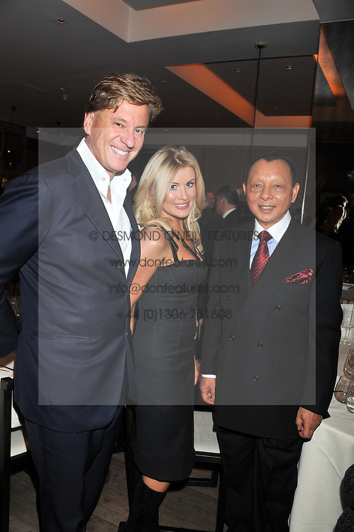 Left to right, ROB & KATIE HERSOV and HH TENGKU ABDULLAH SULTAN ABU BAKAR at a dinner hosted by Marlon & Nadya Abela at Cassis 232-236 Brompton Road, London to thank customers & friends for their custom held on 9th February 2012.