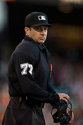 SAN FRANCISCO, CA - JUNE 24:  MLB umpire Jim Reynolds #77 stands on the field before the game between the San Francisco Giants and the San Diego Padres at AT&T Park on June 24, 2015 in San Francisco, California.  The San Francisco Giants defeated the San Diego Padres 6-0. (Photo by Jason O. Watson/Getty Images) *** Local Caption *** Jim Reynolds