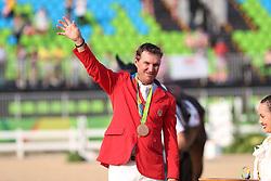 Dutton, Phillip (USA), <br /> Rio de Janeiro - Olympische Spiele 2016<br /> Siegerehrung Vielseitigkeit Einzelentscheidung<br /> © www.sportfotos-lafrentz.de/Stefan Lafrentz