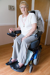 Female wheelchair user at home,