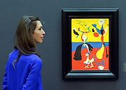 "© Licensed to London News Pictures. 31/01/2013. London, UK A woman looks at Joan Miro's ""Le fernier et son epouse"" estimated to raise 5.5-7.5million GBP.  Preview of highlights from Sotheby's forthcoming February sales of Impressionist & Modern Art and Contemporary Art in London, including works by Picasso, Bacon, Monet, Richter and Miró. Photo credit : Stephen Simpson/LNP"