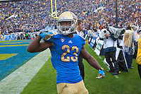 17 October 2012: Tailback (23) Jonathan Franklin of the UCLA Bruins runs the ball, scores a touchdown, and celebrates against the USC Trojans during the second half of UCLA's 38-28 victory over USC at the Rose Bowl in Pasadena, CA.
