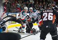 KELOWNA, CANADA - FEBRUARY 28: Joe Gatenby #28 and Tyson Baillie #24 of Kelowna Rockets check a player of the Calgary Hitmen on February 28, 2015 at Prospera Place in Kelowna, British Columbia, Canada.  (Photo by Marissa Baecker/Shoot the Breeze)  *** Local Caption *** Tyson Baillie; Joe Gatenby;
