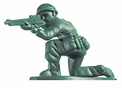 crouching plastic toy soldier with rifle