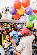 Balloon seller at park in front of Royal Palace, Phnom Penh