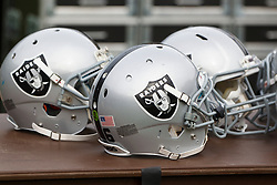 OAKLAND, CA - OCTOBER 21: General view of Oakland Raiders football helmets on the sidelines before the game against the Jacksonville Jaguars at O.co Coliseum on October 21, 2012 in Oakland, California. The Oakland Raiders defeated the Jacksonville Jaguars 26-23 in overtime. Photo by Jason O. Watson/Getty Images) *** Local Caption ***