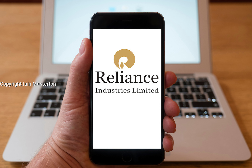 Using iPhone smartphone to display logo of Reliance Industries; Indian conglomerate holding company