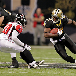 2009 November 02: New Orleans Saints running back Mike Bell (21) runs at Atlanta Falcons cornerback Brent Grimes (20) during a 35-27 win by the Saints over the Falcons at the Louisiana Superdome in New Orleans, Louisiana.