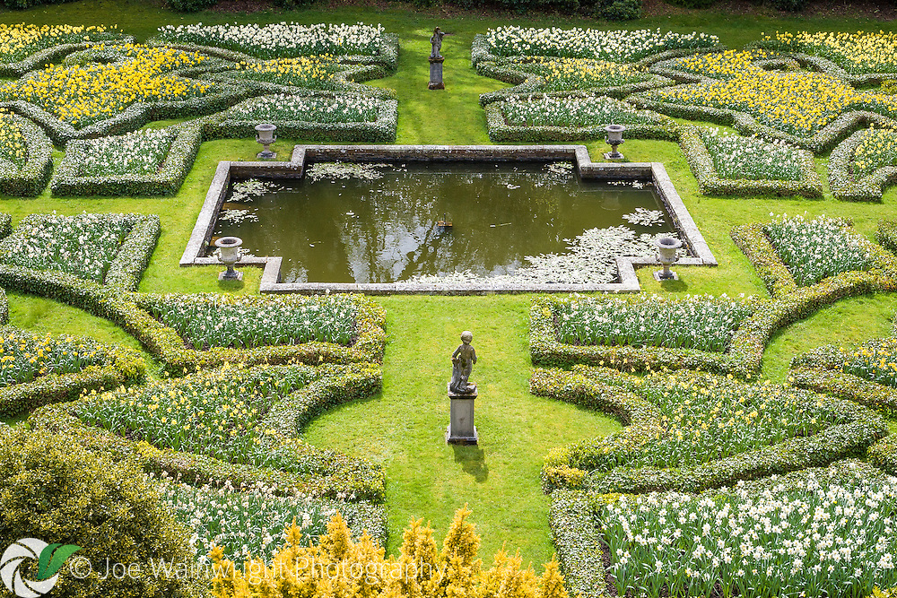 The large sunken Dutch Garden at Lyme Park, Cheshire, was created in the early 18th century.  Its intricately shaped beds are edged in ivy and filled with seasonal flower displays.