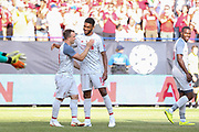 Liverpool Xherdan Shaqiri celebrates his goal 1-4 Liverpool defender Joe Gomez (12) during the Manchester United and Liverpool International Champions Cup match at the Michigan Stadium, Ann Arbor, United States on 28 July 2018.