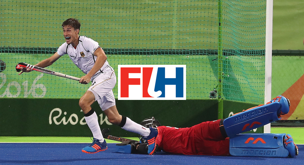 RIO DE JANEIRO, BRAZIL - AUGUST 14:  Florian Fuchs of Germany scores the match winning last second goal during the Men's hockey quarter final match between the Germany and New Zealand on Day 9 of the Rio 2016 Olympic Games at the Olympic Hockey Centre on August 14, 2016 in Rio de Janeiro, Brazil.  (Photo by David Rogers/Getty Images)