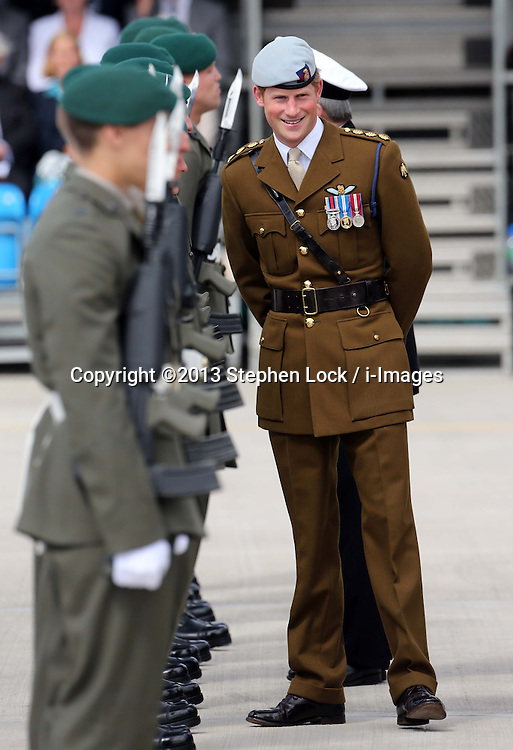 Prince Harry during a visit to the Royal Marines Tamar at the HM Naval Base in Devonport, Plymouth, Friday, 2nd August 2013<br /> Picture by Stephen Lock / i-Images