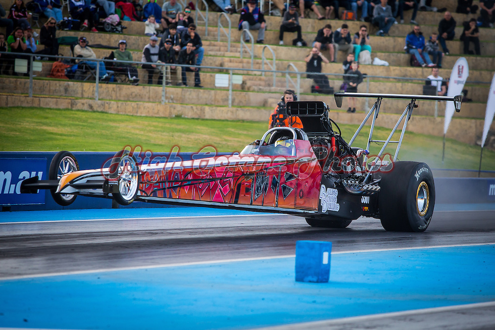 Shane Weston (3301) lifts the front wheels in the Weston Racing 'Endangered Species' Top Alcohol Dragster at the Perth Motorplex.