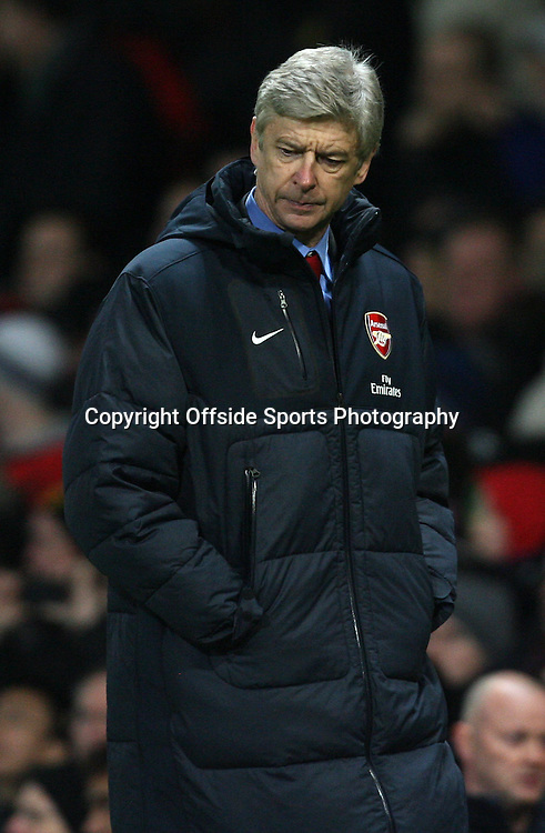 13/12/2010 - Barclays Premier League - Manchester United vs. Arsenal - Arsenal manager Arsene Wenger looks dejected - Photo: Simon Stacpoole / Offside.