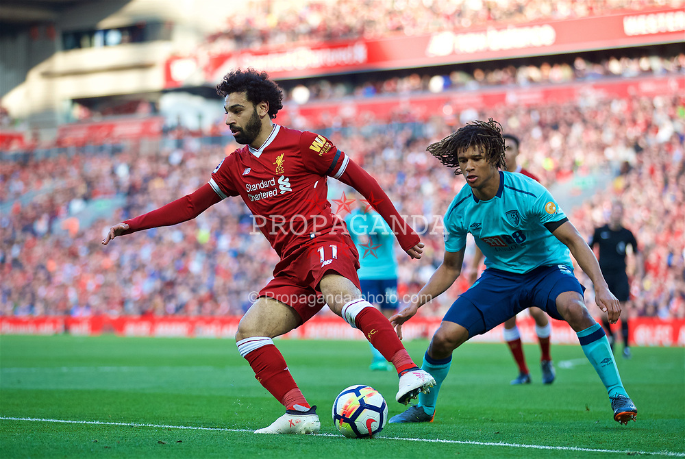 LIVERPOOL, ENGLAND - Saturday, April 14, 2018: Liverpool's Mohamed Salah and AFC Bournemouth's Nathan Ake during the FA Premier League match between Liverpool FC and AFC Bournemouth at Anfield. (Pic by Laura Malkin/Propaganda)