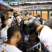 NEW YORK, NEW YORK - June 14:  Jung Ho Kang #27 of the Pittsburgh Pirates bows to his teammates in the dugout after hitting a two run home run in the sixth inning during the Pittsburgh Pirates Vs New York Mets regular season MLB game at Citi Field on June 14, 2016 in New York City. (Photo by Tim Clayton/Corbis via Getty Images)