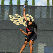 10 November 2017:  The San Diego State Aztecs women's tennis team hosts it's annual Fall Classic II. Nnena Nadozie seen here serving the ball during a doubles match.<br /> www.sdsuaztecphotos.com