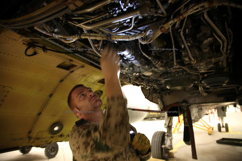 A mechanic inspects a Tornado jet in Camp Marmal, Mazar-e Sharif