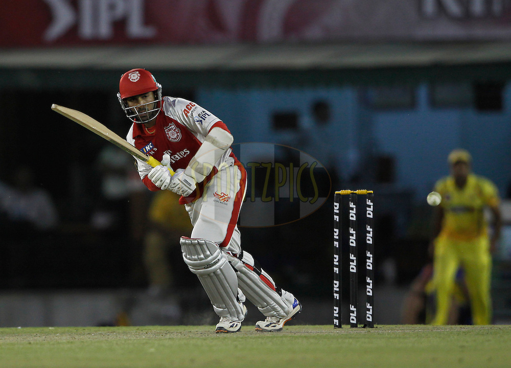 Kings XI Punjab Kings XI Punjab Dinesh Karthik plays a shot during match 9 of the Indian Premier League ( IPL ) Season 4 between the Kings XI Punjab and the Chennai Super Kings held at the PCA stadium in Mohali, Chandigarh, India on the 13th April 2011..Photo by Pankaj Nangia/BCCI/SPORTZPICS