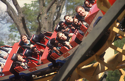 People riding roller coaster ride at adventure park,