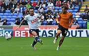 Adam Le Fondre looks to open up bolton and plays the ball inside during the Sky Bet Championship match between Bolton Wanderers and Wolverhampton Wanderers at the Macron Stadium, Bolton, England on 12 September 2015. Photo by Mark Pollitt.