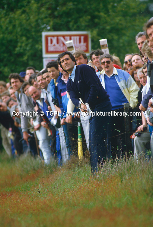 Seve BALLESTEROS (SPN) plays a delicate second shot to the 18th green while pressed against a wire fence and goes on to win during fourth round Dunhill British Masters 1991,Dukes Course, Woburn Golf and CC,Beds, England.
