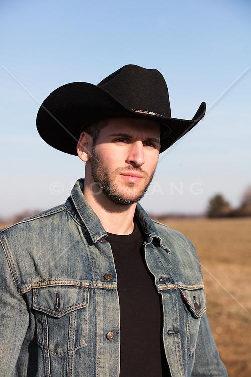 portrait of a masculine cowboy outdoors