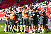 Leeds United players huddle during the warm up during the EFL Sky Bet Championship match between Stoke City and Leeds United at the Bet365 Stadium, Stoke-on-Trent, England on 24 August 2019.