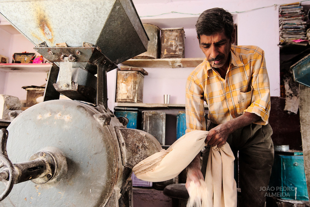 Miller working at a small mill inside Udaipur old town