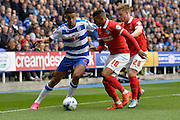Reading's Nick Blackman holds off two Charlton Athletic players during the Sky Bet Championship match between Reading and Charlton Athletic at the Madejski Stadium, Reading, England on 17 October 2015. Photo by Mark Davies.